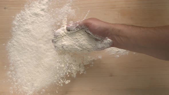 Download Man Hand Pouring Out Flour On A Wooden Surface Tabletop Cooking And Baking nulled download