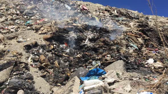 Download Big Heap Of Garbage Burning At Landfill nulled download
