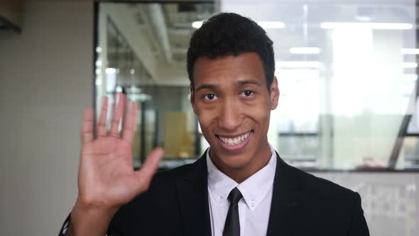 Download Hello, Waving Hand by Black Businessman in Suit in Office nulled download