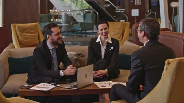 Download Business Meeting in the Hotel Lobby Area nulled download