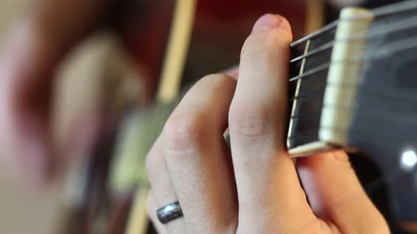 Download Musician Playing An Acoustic Guitar nulled download