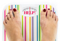 "Feet on bathroom scale with word ""Help"" on dial - PhotoDune Item for Sale"