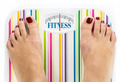 "Feet on bathroom scale with word ""Fitness"" on dial - PhotoDune Item for Sale"