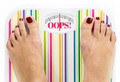 "Feet on bathroom scale with word ""Oops"" on dial - PhotoDune Item for Sale"