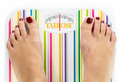 "Feet on bathroom scale with word ""Exercise"" on dial - PhotoDune Item for Sale"