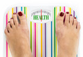 "Feet on bathroom scale with word ""Health"" on dial - PhotoDune Item for Sale"