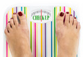 "Feet on bathroom scale with words ""Check up"" on dial - PhotoDune Item for Sale"