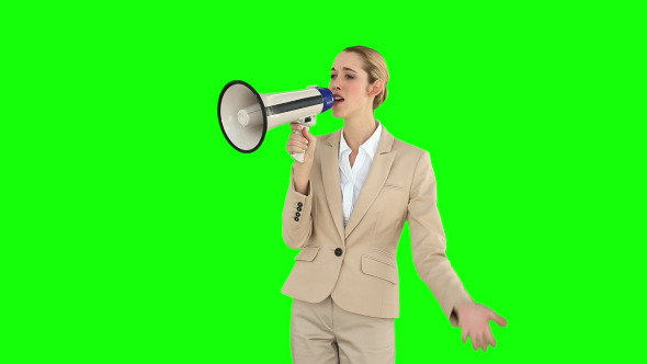 Positive Businesswoman Shouting In To Megaphone 1