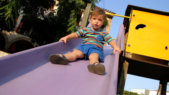 Baby Toddler on the Park Slide 01