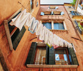 Underwear drying on the rope in the old yard in Italy - PhotoDune Item for Sale