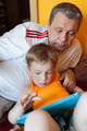 Grandfather and grandson with touch pad - PhotoDune Item for Sale