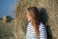 Young woman by the hay roll in the field - PhotoDune Item for Sale