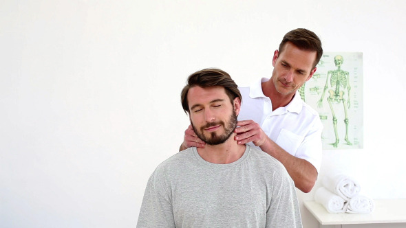 Physiotherapist Touching Patients Injured Neck