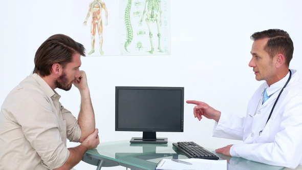 Patient Talking With His Doctor About Injury