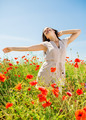 smiling young woman on poppy field - PhotoDune Item for Sale
