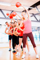 group of smiling people working out with ball - PhotoDune Item for Sale
