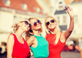 three beautiful girls taking picture in the city - PhotoDune Item for Sale