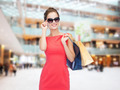 smiling elegant woman in dress with shopping bags - PhotoDune Item for Sale