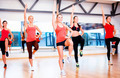 group of smiling women exercising in the gym - PhotoDune Item for Sale