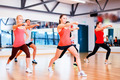 group of smiling people exercising in the gym - PhotoDune Item for Sale
