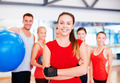 woman standing in front of the group in gym - PhotoDune Item for Sale