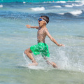 little boy running through the water on the beach - PhotoDune Item for Sale