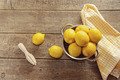 Fresh lemons on wooden counter - PhotoDune Item for Sale