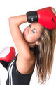Young beautiful boxer woman with red boxing gloves over white background - PhotoDune Item for Sale