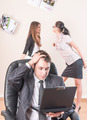 Distressed businessman works with laptop over colleagues background in office - PhotoDune Item for Sale