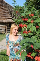 girl with red guelder-rose besides an rural house - PhotoDune Item for Sale