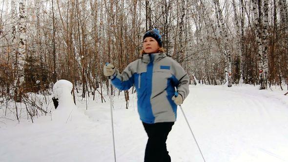 Nordic Walking adult woman in winter