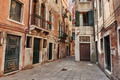 Narrow street in the old town in Venice Italy - PhotoDune Item for Sale