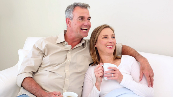 Couple Drinking Coffee On The Couch 2