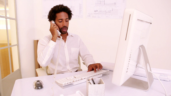 Businessman Working At His Desk 2