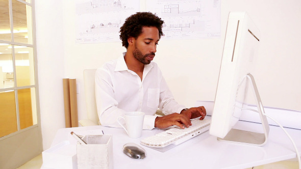 Businessman Working At His Desk 3