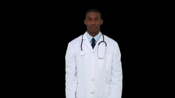 Serious Young Doctor Showing Tablets To Camera 1