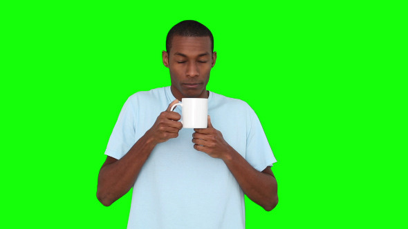 Casual Young Man Enjoying Cup Of Coffee 2