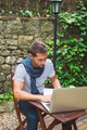 Young man working with laptop in outdoors. - PhotoDune Item for Sale