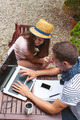 Young couple working with laptop in outdoors. - PhotoDune Item for Sale