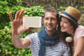 Young couple taking selfie with smart phone camera in outdoors. - PhotoDune Item for Sale