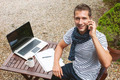 Young man working talking with smart phone in outdoors. - PhotoDune Item for Sale