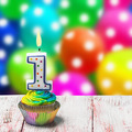 Cupcake with number one on the background of balloons - PhotoDune Item for Sale