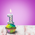 Cupcake with number one on a purple background - PhotoDune Item for Sale