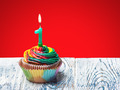 Cupcake with number one on a red background - PhotoDune Item for Sale