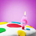 Burning candle with the number five on a birthday cake - PhotoDune Item for Sale