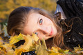 Girl lying in leaves - PhotoDune Item for Sale