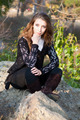 Girl sitting on the stones - PhotoDune Item for Sale