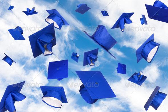 Stock Photo - PhotoDune Graduation caps in flight 882684