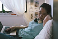 Casual young woman sleeping on bed while using laptop at home. - PhotoDune Item for Sale