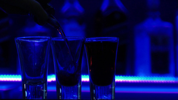 Pouring Three Shots of Clear Alcoholic Drink-2
